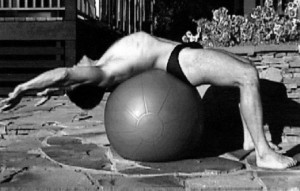 Michael Colgan demonstrating an abdominal stretch on the Swiss ball.